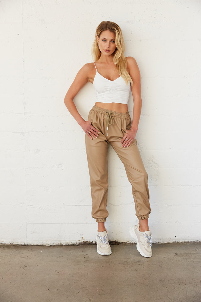 Tan leather joggers.
