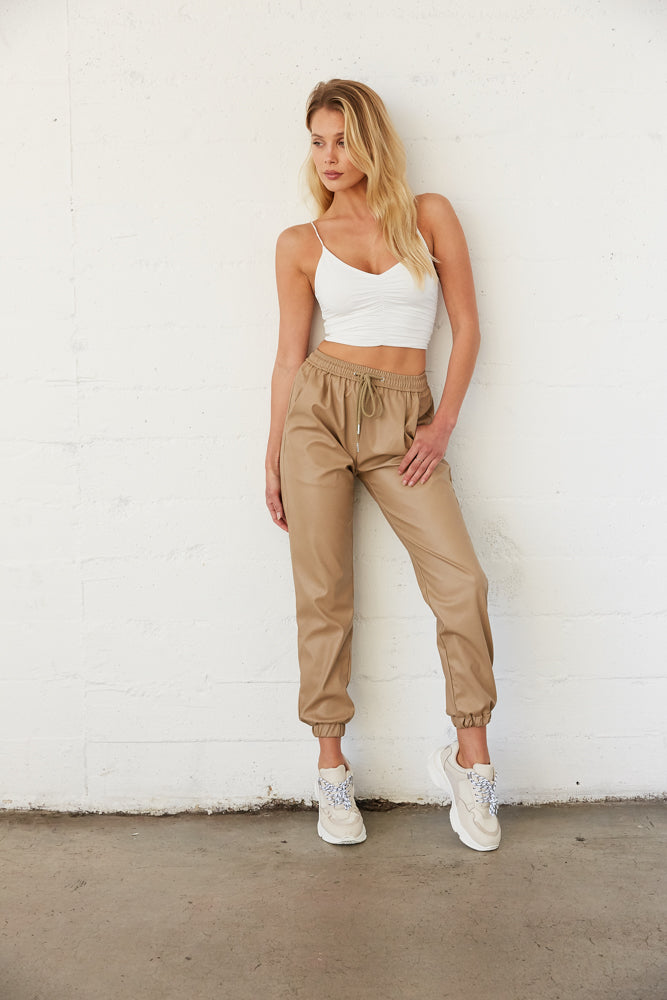 Tan baggy joggers with elastic waistband.