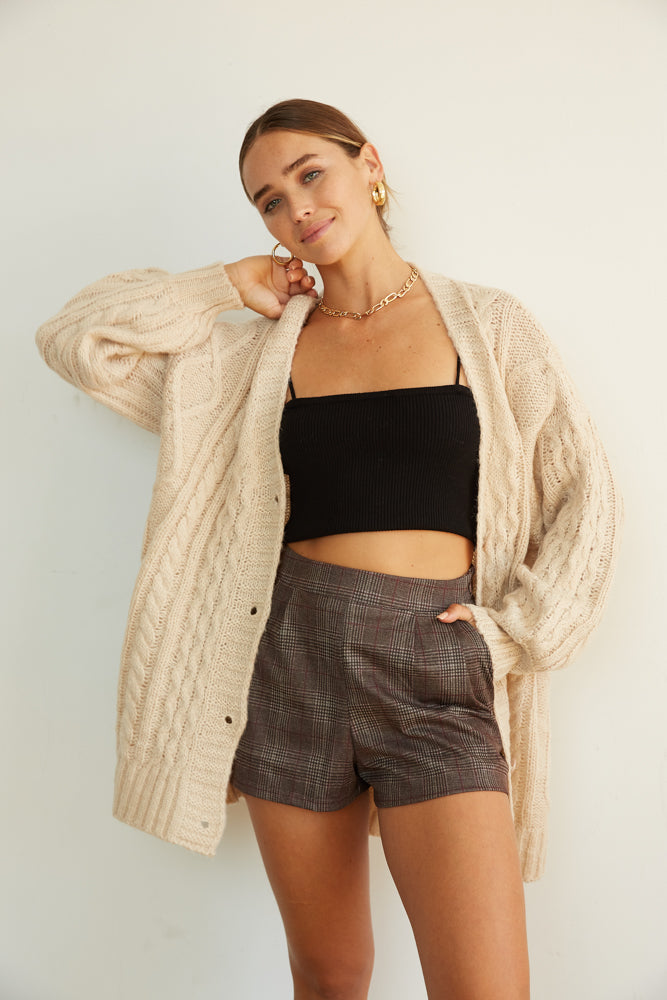 This cozy sweater is complete with a button up front.