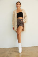Tan cardigan sweater.