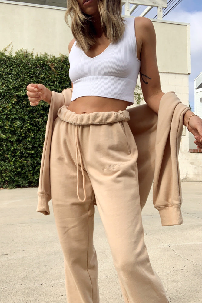 Tan high rise sweatpants with rollover waist and drawstring tie.