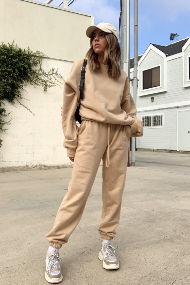 Tan sweatpants with matching oversized sweatshirt.