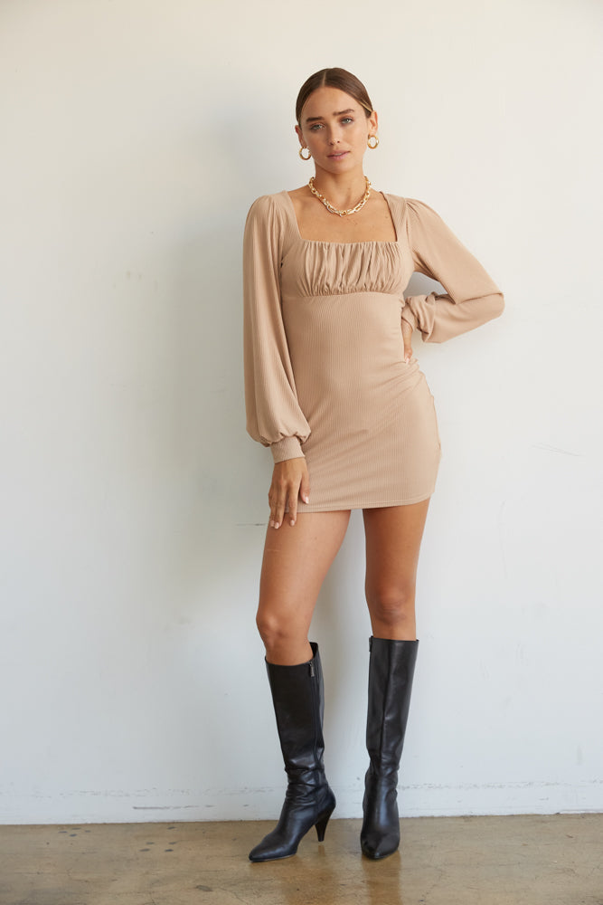 This mini dress is available in mocha.