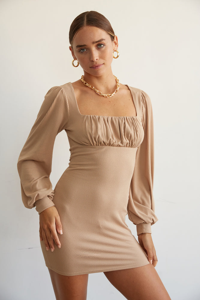 This mini dress has long billowy sleeves.
