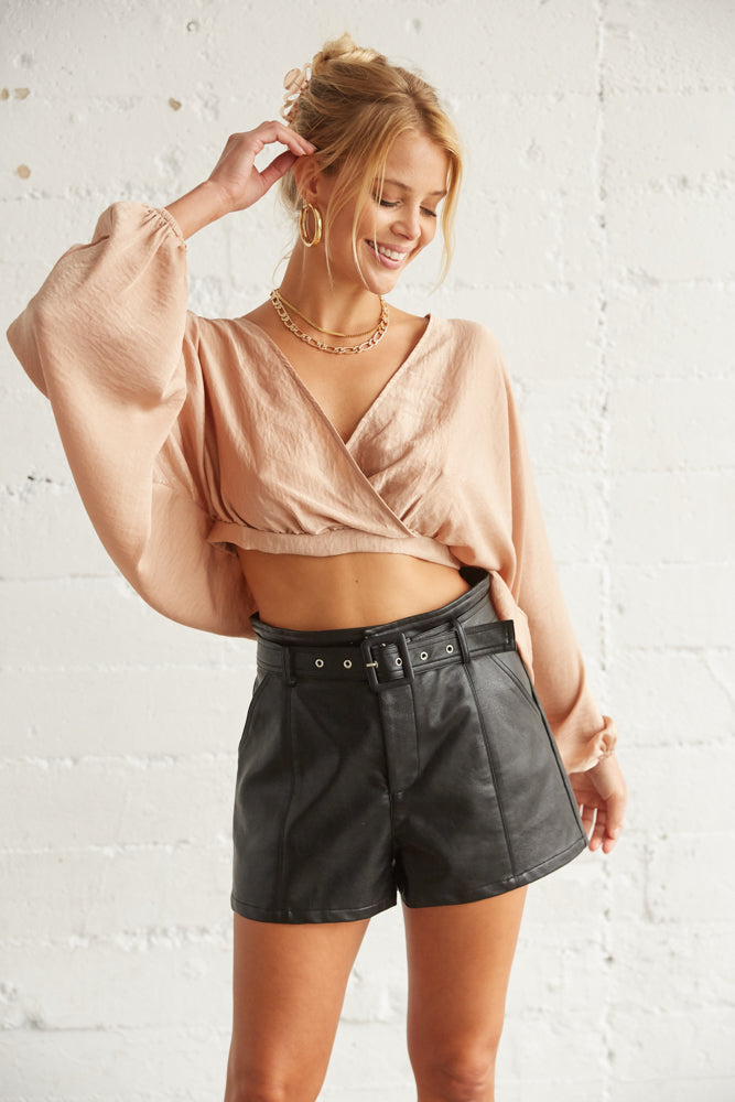 Black belted leather shorts.