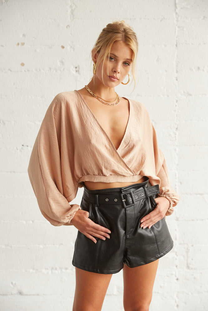 This top has a wrap V neckline.