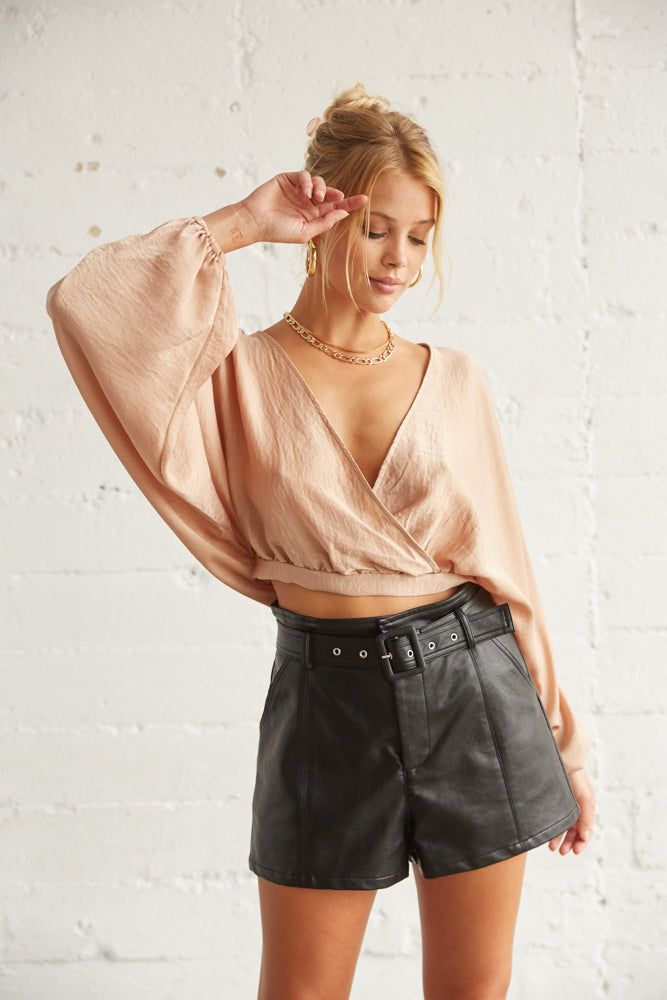 Satin wrap top with long billowy sleeves.