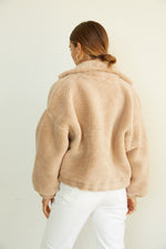 The back of this teddy jacket is cozy and relaxed.