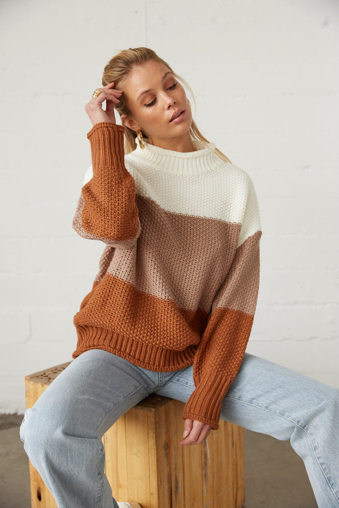 Oversized knit sweater with mock neckline.