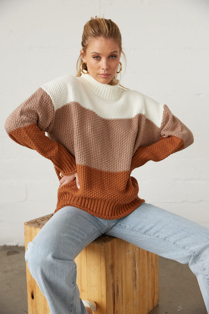 Boxy knit sweater with striped design.