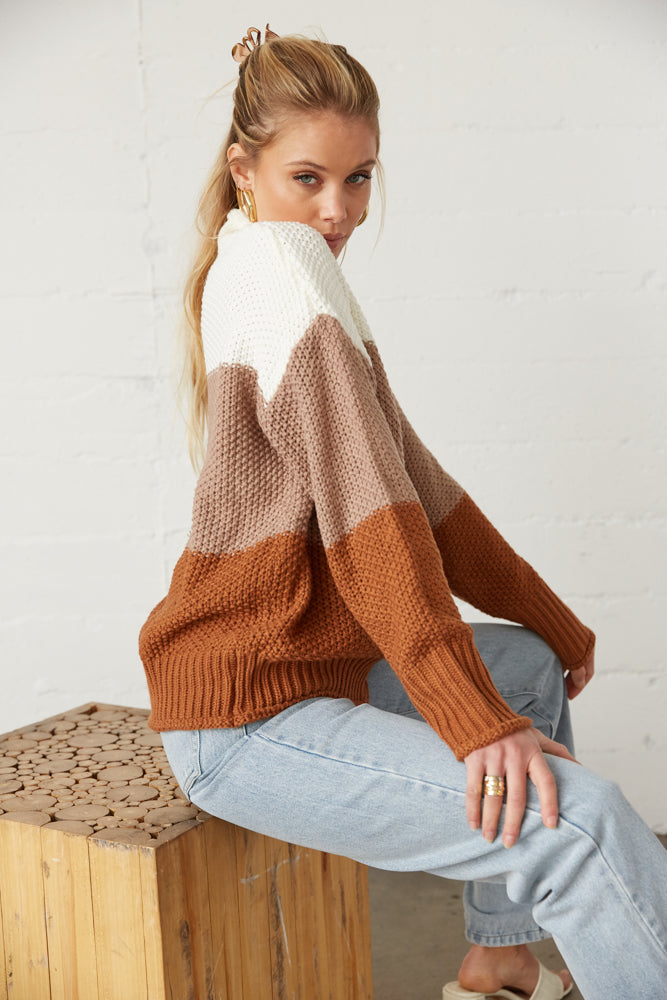 The side of this sweater has long sleeves and ribbed armholes.