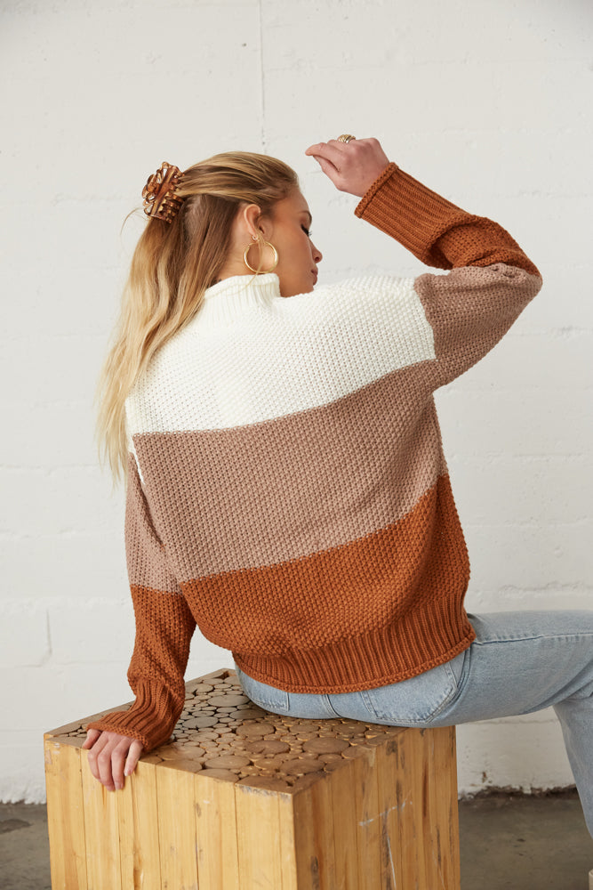 the back of this colorblock sweater has a ribbed hem.