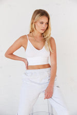 White v neck tank top.