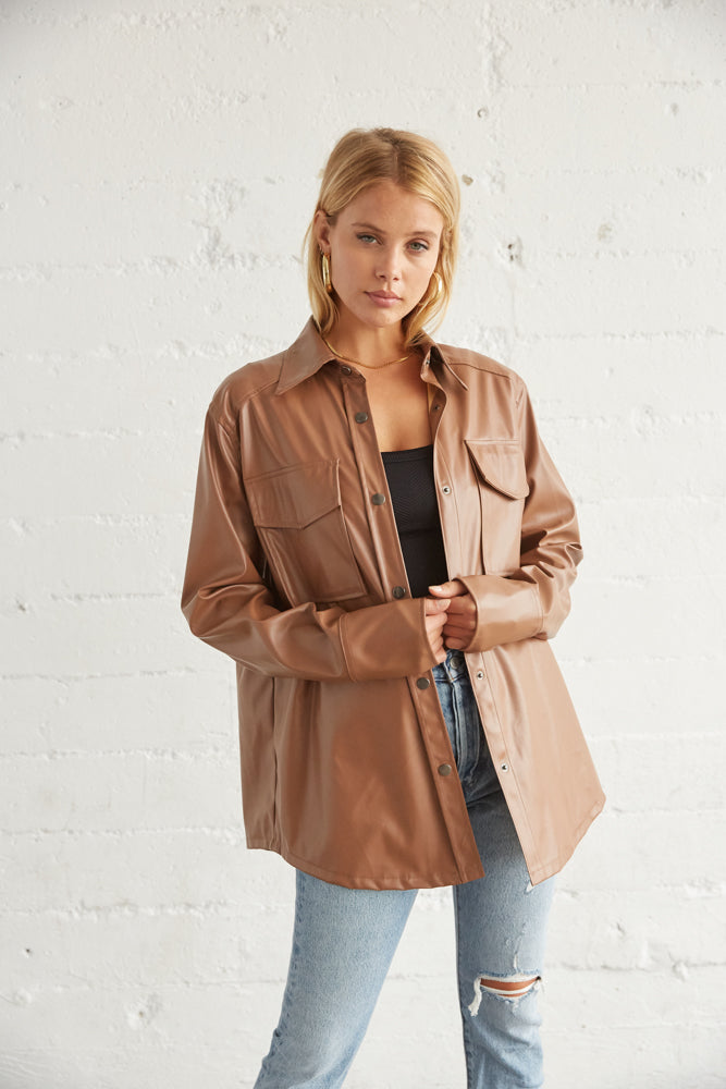 brown leather shirt jacket with button up front.