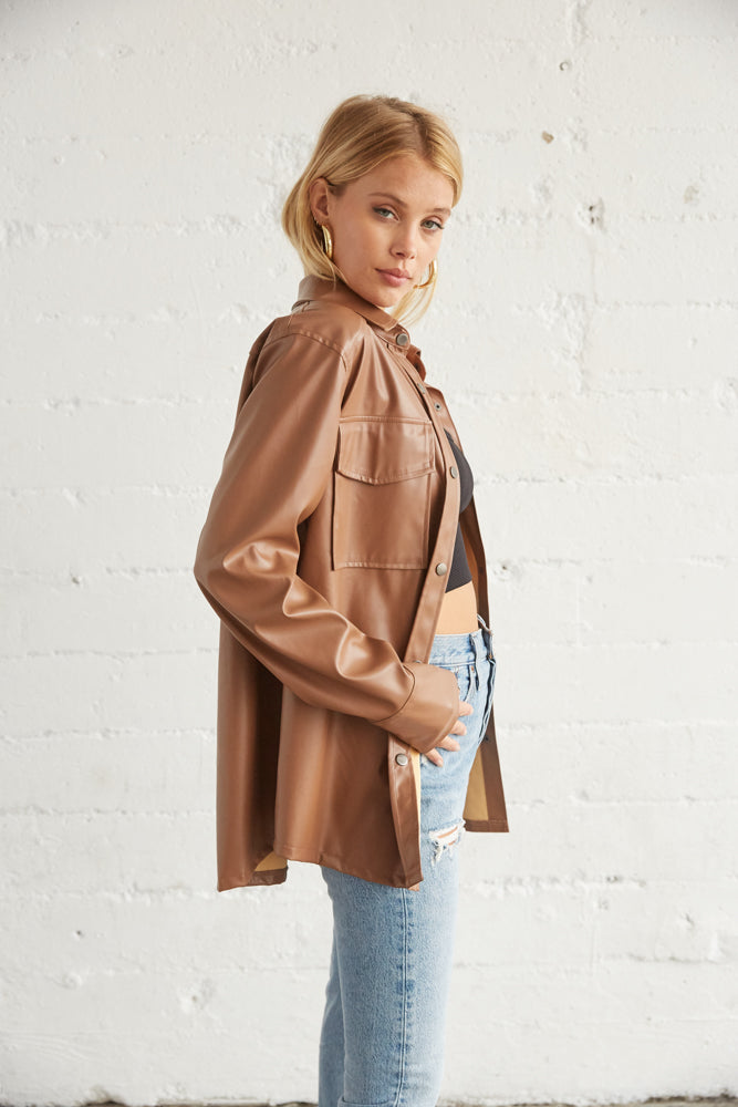 Brown leather shirt with long sleeves.