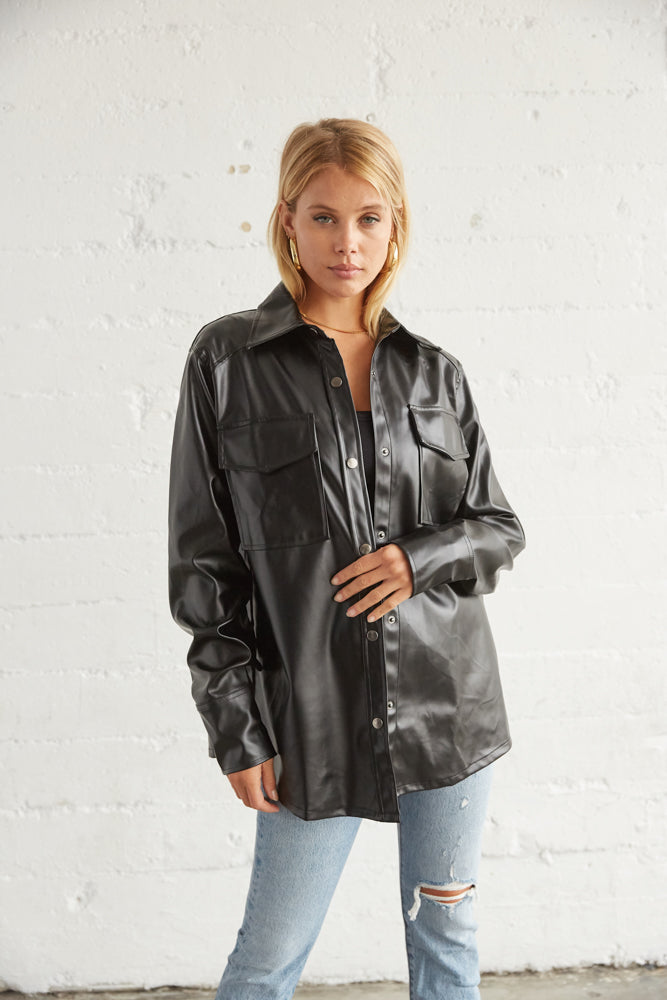 Black leather shacket with button up front.