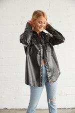Black leather jacket with front buttons.