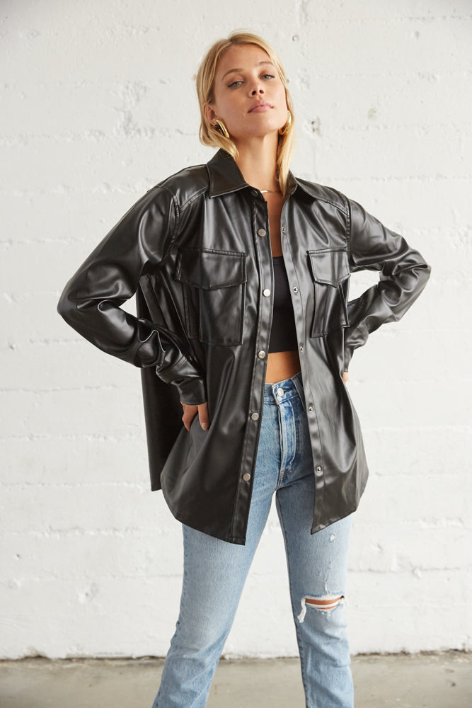 Black leather jacket with long sleeves.
