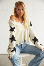 Black and white star print sweater.