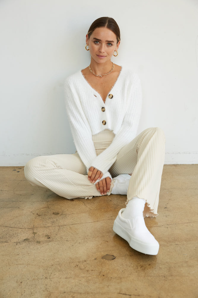 White crop fuzzy sweater with button up front.