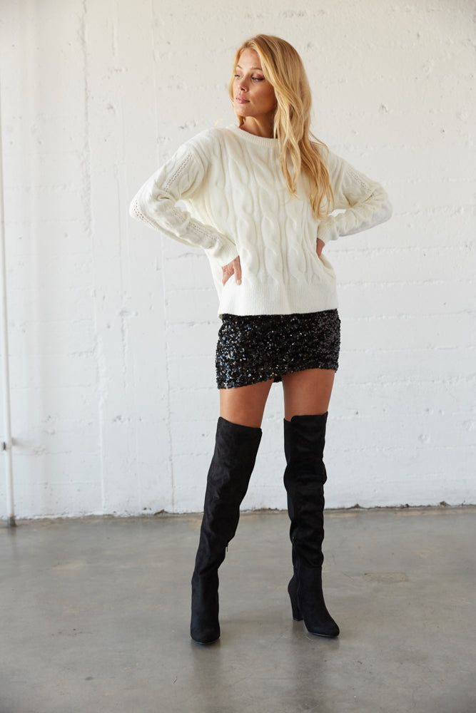 This white oversized sweater is the perfect fit.