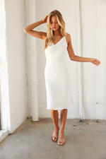 White midi dress with cowl neckline.