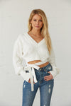 White cableknit sweater with long sleevesd.