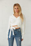 White v neck crop sweater.