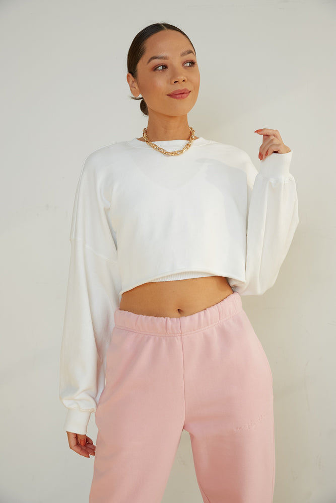 White cropped sweatshirt.