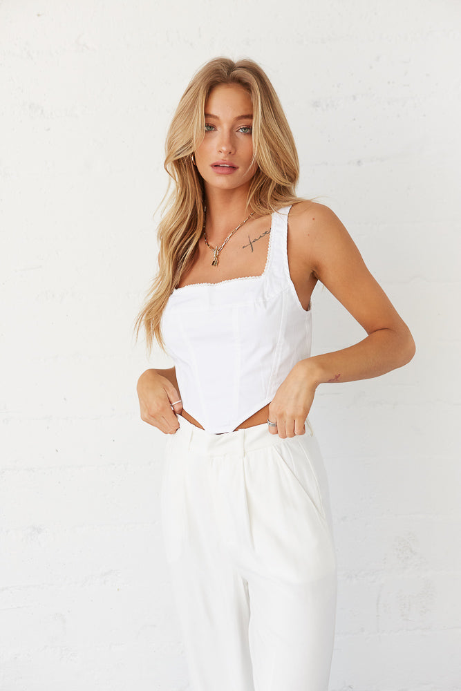White sleeveless crop top with square neckline.