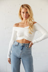 White ribbed off shoulder crop top.