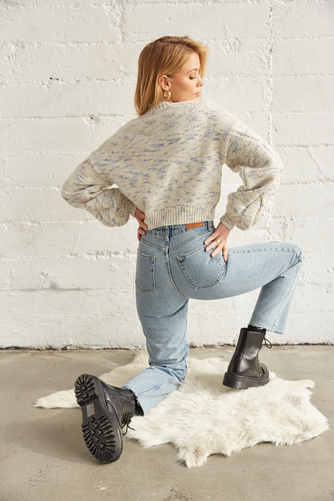 The back of this sweater is cropped with a ribbed hem.