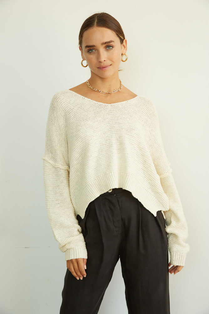 Oversized knit sweater with exposed seams.