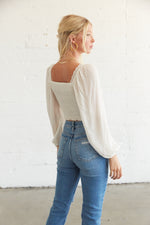 The back of this crop top has a smocked back for an easy fit.