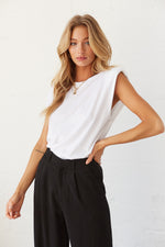 White muscle tee with dropped armholes.