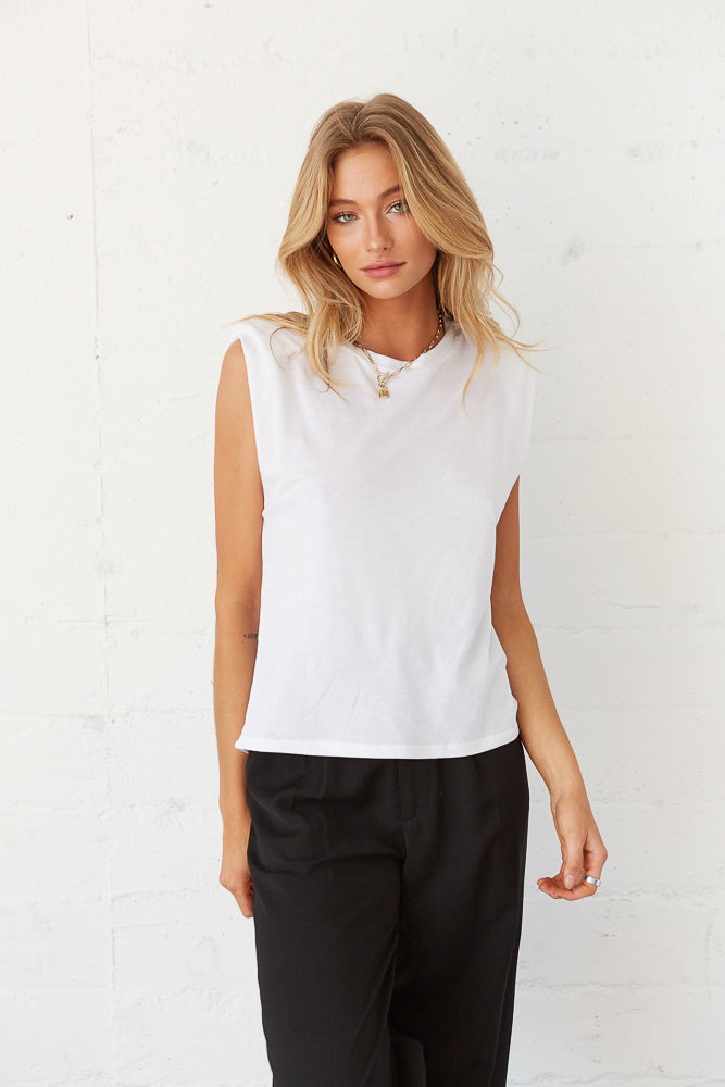 White boxy muscle tee with black trousers.