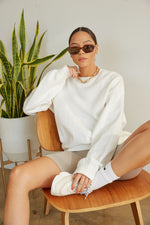 White oversized crew neck sweater.