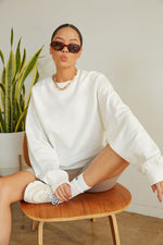 White crew neck sweater.