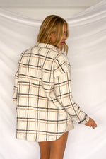 The back of this shirt jacket is relaxed with a plaid print.