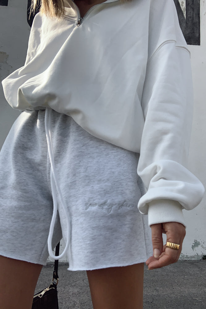 Heather grey sweat shorts with embroidered detailing.