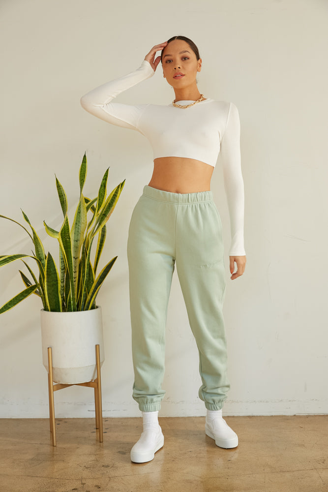 Raw edge crop top with long sleeves.