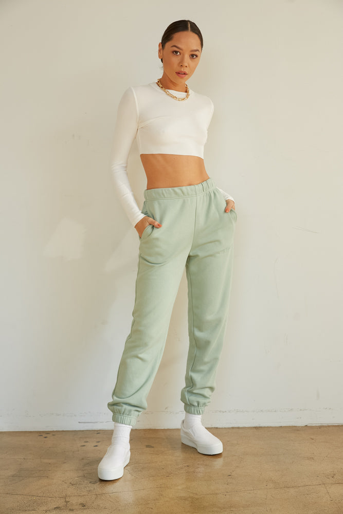 Crew neck crop top with raw hem.