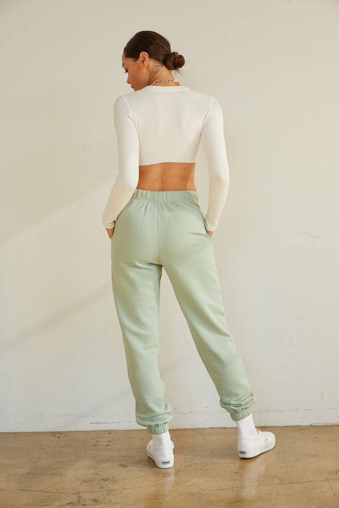 The back of this white crop top is simple and ribbed.