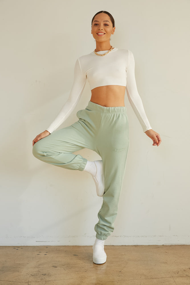 White ribbed crop top with raw hem.
