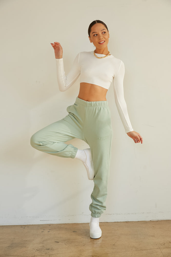 White ribbed crop top with long sleeves.