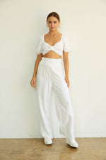 White smocked crop top with matching linen pants.