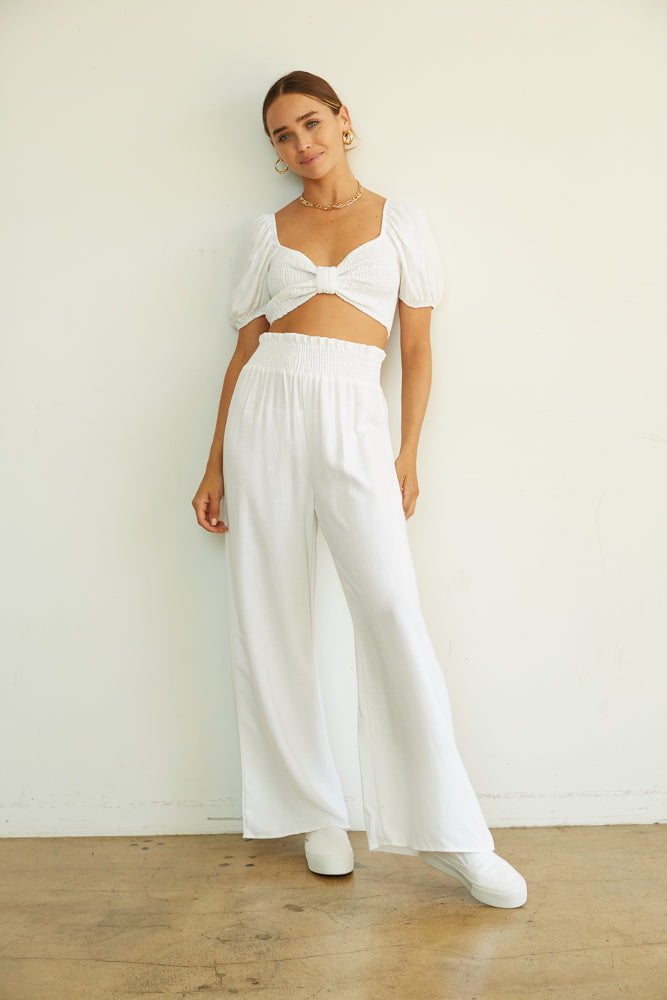 White linen pants with matching white crop top.