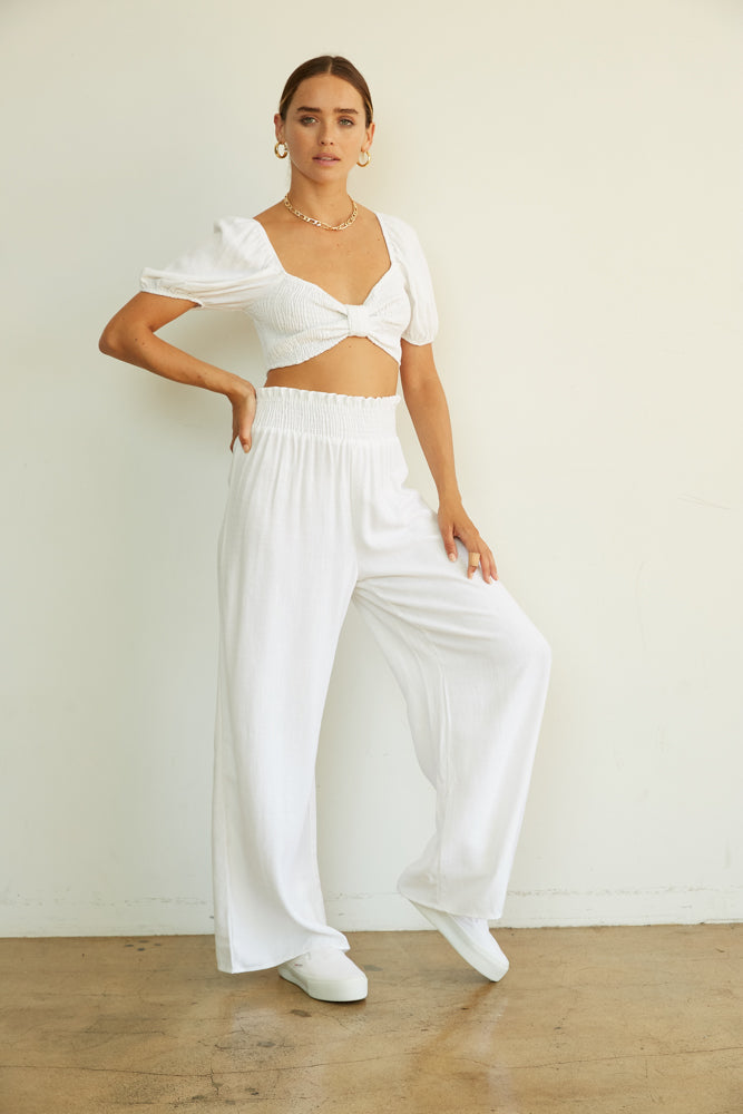 Smocked crop top with wide leg pants.
