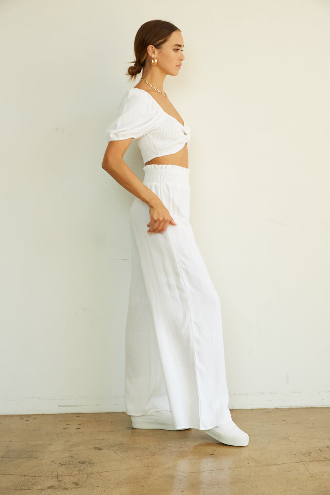 The side of these wide leg pants are relaxed.