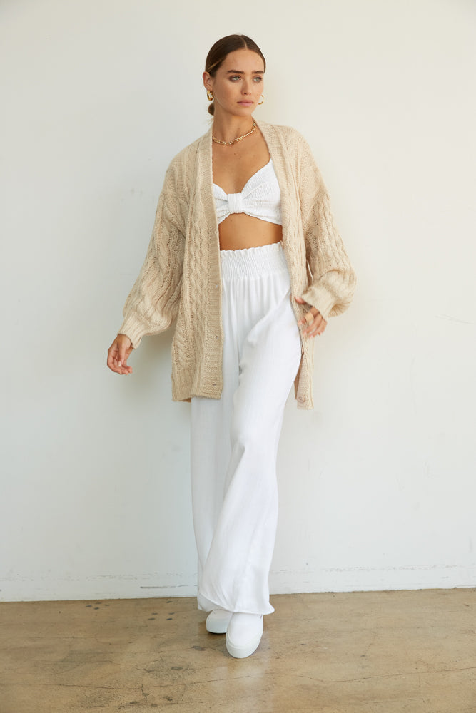 Cozy white linen set with chunky knit sweater.